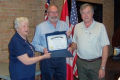 KI-Past-International-President-John-Button-presents-charter-celebrating-the-merger-of-two-Chatham-clubs-to-become-the-Kiwanis-Club-of-Chatham-Kent