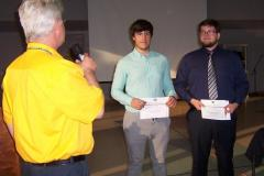 Robotics-team-members-are-thanked-for-their-presentation-by-Kiwanian-Brett-Service